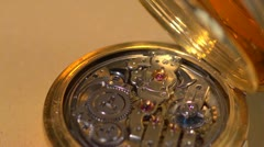 Chimes working on an early Swiss Pocket Watch - with audio - stock footage