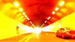 Traffic driving transportation urban city night fast cars street tunnel Stock Footage