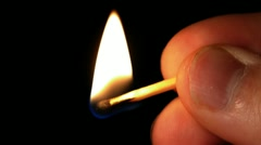 HD - Man hold a lighted match - stock footage