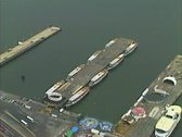 Stock Video Footage of Aerial shot of Circle Line Sightseeing boats moored at their pier