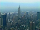 Stock Video Footage of Aerial view of Midtown Manhattan centered on the Empire State Building