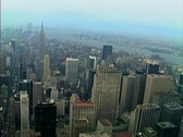 Stock Video Footage of Aerial shot of midtown Manhattan including the GE building and St Patricks