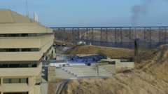 Lethbridge University, train trestle over coulee, zoom out, winter. Stock Footage
