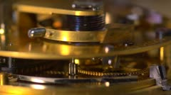 Close up of an Earnshaw watch movement, cogs and spring, slomo Stock Footage