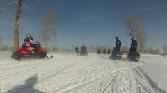 Snowmobile club departs on trail P HD 0052 Stock Footage