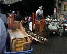 Fishmongers and Traffic at Tsukiji Fish Market, Tokyo Japan GFSD Stock Footage