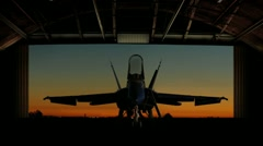 F-18 Super Hornet revealed as hangar doors open slowly. - stock footage