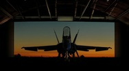 Stock Video Footage of F-18 Super Hornet revealed as hangar doors open slowly.