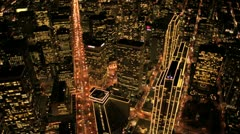 Stock Video Footage of Aerial night view of skyscrapers and streets, Metropolis, USA