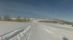 Snowmobile turn in powder P HD 0052 Stock Footage