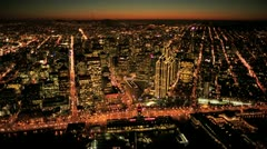 Aerial sunset low angled illuminated view of Fishermans Wharf, San Francisco, US Stock Footage
