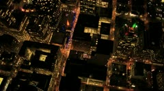 Aerial night  illuminated vertical view of rolling roads city traffic, USA - stock footage