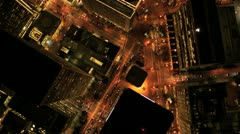 Aerial vertical view at night of city traffic illuminated by city streets, USA Stock Footage
