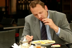 Businessman eating lunch in cafe, steadicam shot NTSC Stock Footage