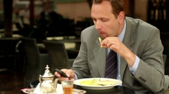 Businessman in cafe using cellphone, steadicam shot HD - stock footage