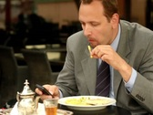 Businessman in cafe using cellphone, steadicam shot NTSC Stock Footage