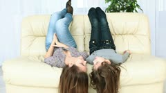 Teenagers lying on the couch Stock Footage