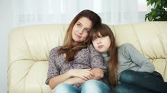 Teenagers sitting on the couch and yawning - stock footage