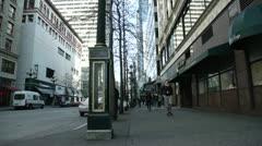 Clock on the city corner crane shot Stock Footage