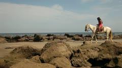 Woman riding White Horse Stock Footage