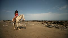 Woman riding Horse At Beach Stock Footage