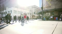Pedestrians crossing the street. Crane shot.  Stock Footage