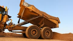 Heavy vehicles Heavy mining soil loader road vehicles truck digging Asphalt Stock Footage