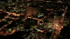 Aerial night illuminated view of city blocks and streets, America Stock Footage