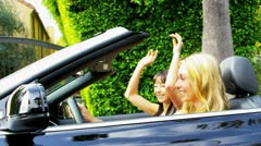 Beautiful Girls Driving a Convertible Stock Footage