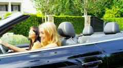 Young Girls in Open Top Car Stock Footage