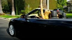 Pretty Girlfriends Enjoying Driving a Convertible Stock Footage