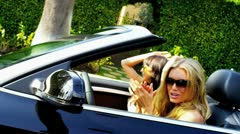 Girlfriends on Vacation Driving Open Top Car Stock Footage