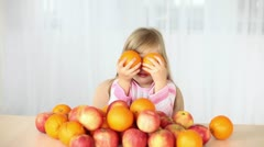 Girl dabbles with oranges - stock footage