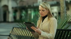 Businesswoman on a tablet outside - stock footage