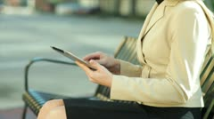 Businesswoman using a tablet outside Stock Footage