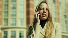 Woman outside on cell phone - stock footage