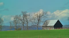 Old barn and clouds timelapse Stock Footage