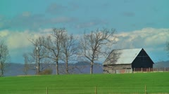 Old barn and clouds peaceful scene Stock Footage
