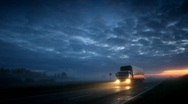 Stock Video Footage of Trucker goes on night road