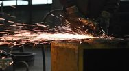 Stock Video Footage of Men at work grinding steel