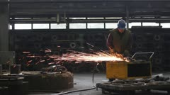 Men at work grinding steel - stock footage