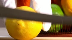 Fruits, lemon and orange, slice, 2 clips Stock Footage
