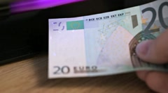 Testing euro note under UV light Stock Footage