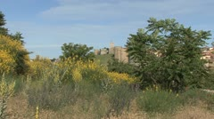 Avila Spain walls and yellow flowers zooms in Stock Footage