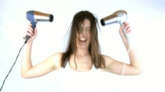 Beautiful woman fights with 2 blow dryer Stock Footage