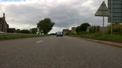 Driving time lapse onto main road - rear view Stock Footage