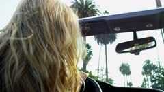 Beautiful Girl Swinging Hair Driving Convertible Stock Footage