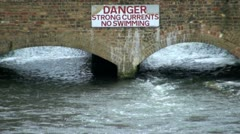 Warning of Dangerous Swimming Conditions on River Bridge Stock Footage