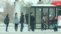 People waiting at the bus stop 7 Stock Footage