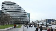 People walking near City Hall, Greater London Authority, Mayor, Thames River Stock Footage